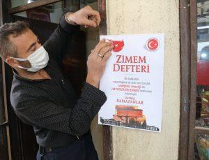 """Yozgat'ta üniversite öğrencileri """"zimem defteri"""" uygulamasıyla bir bakkalda vatandaşın borcunu kapattı"""