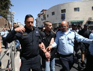 İsrail polisi işgal altındaki Doğu Kudüs'te eylem yapan Filistinlileri darbetti